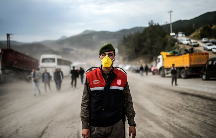 A soldier stands guard on a road leading to the site where 120 workers were believed to remain trapped in a mine after a deadly explosion that claimed the lives of at least 238 people on May 14, 2014 in a coal mine of the western Turkish province of Manisa. (AFP Photo / Bulent Kilic)