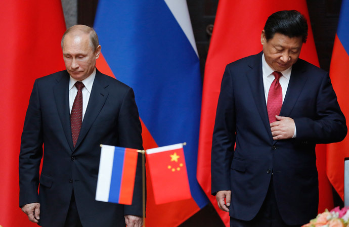 Russia's President Vladimir Putin (L) and China's President Xi Jinping attend an agreement signing ceremony during a bilateral meeting at Xijiao State Guesthouse ahead of the fourth Conference on Interaction and Confidence Building Measures in Asia (CICA) summit, in Shanghai May 20, 2014.(Reuters / Carlos Barria)