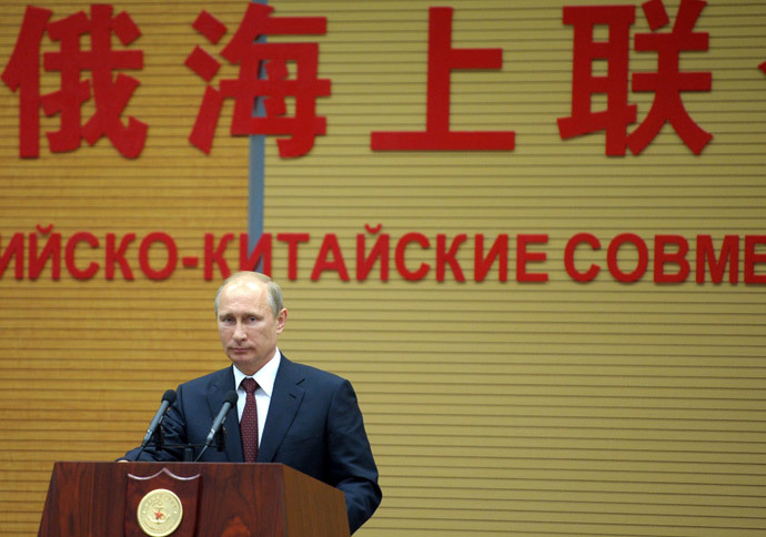 Russia's President Vladimir Putin speaks at the opening ceremony for the Naval Cooperation 2014 joint China-Russia naval exercise at a command center of the Wusong naval base in Shanghai on May 20, 2014.(AFP Photo / Alexey Druzhinin )