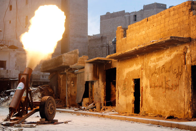 Free Syrian Army fighters fire a self-made rocket towards forces loyal to Syria's President Bashar al-Assad in Bustan al-Basha district in Aleppo May 19, 2014.(Reuters / Hosam Katan)