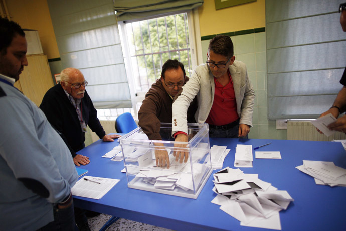 Members of the electoral table count the ballots after the European Parliament elections at a polling station in Ronda, near Malaga, southern Spain, May 25, 2014. (Reuters/Jon Nazca)