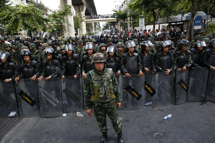 Thai soldiers stand guard as they block a street during a protest against military rule in central of Bangkok May 24, 2014. (Reuters)