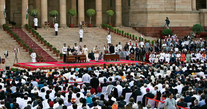 Narendra Modi takes the oath of office as India's new Prime Minister at the Presidential Palace in New Delhi on May 26, 2014. (AFP Photo / Prakash Singh)