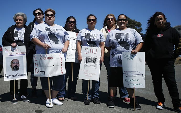 Family members of Pelican Bay inmate Antonio Guillen stand outside San Quentin State Prison in support of inmates who are participating in a state-wide prisoner hunger strike demanding an end to indefinite solitary confinement in California's prison system in San Quentin, August 3, 2013. (Reuters / Stephen Lam)
