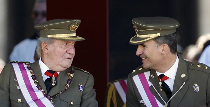 Spain's Crown Prince Felipe smiles next to his father King Juan Carlos (L) as they attend a ceremony marking the bicentennial of the creation of the order of Saint Hermenegildo at the Monastery of San Lorenzo de El Escorial, outside Madrid June 3, 2014. (Reuters/Sergio Perez)