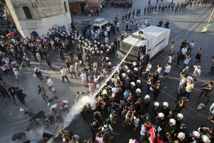 Riot police use a water cannon to disperse demonstrators during a protest at Taksim Square in central Istanbul July 6, 2013. (Reuters)