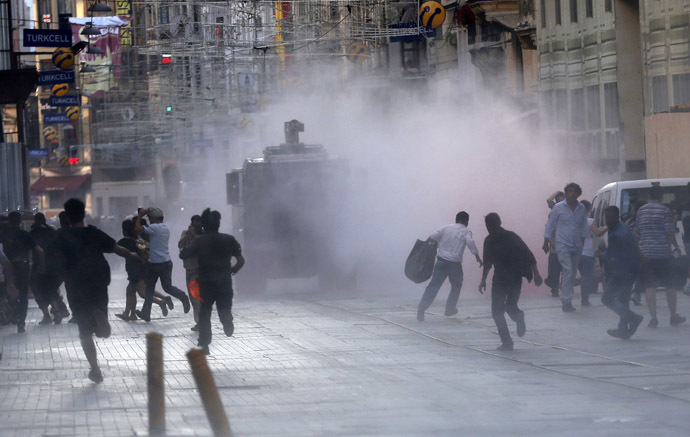Riot police use a water cannon to disperse protesters in central Istanbul July 8, 2013. (Reuters)
