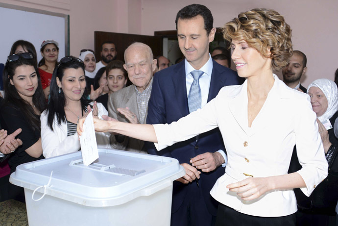 Syria's President Bashar al-Assad and his wife Asma cast their votes in the country's presidential elections at a polling station in Damascus June 3, 2014, in this handout released by Syria's national news agency SANA. (Reuters/SANA)