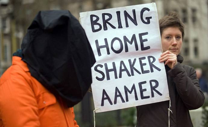 A protestor holds up a sign calling for the release of Shaker Aamer from the Guantanamo prison during a demonstration in central London, on January 11, 2010. (AFP Photo/Leon Neal)