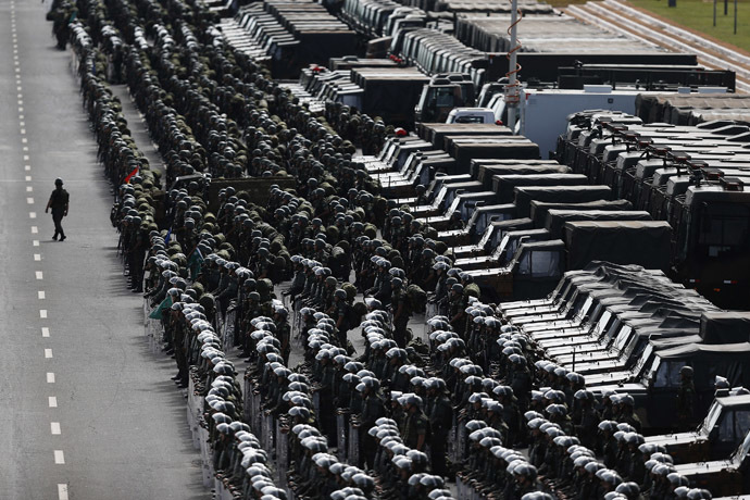 Members of the Brazilian Army, Navy and Air Force attend a presentation of Defence and Security personnel and equipment that will be used during the 2014 World Cup in Brasilia, June 8, 2014. (Reuters/Ueslei Marcelino)