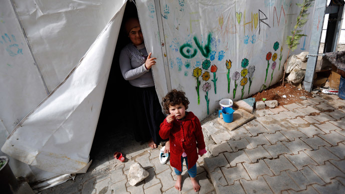 Haqima, a 14-year old Syrian refugee, and her sister Nour stand in their tent at a refugee camp in Nizip in Gaziantep province, near the Turkish-Syrian border.(Reuters / Murad Sezer)