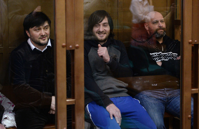 From left: Rustam Makhmudov, Ibragim Makhmudov and Sergei Khadzhikurbanov, defendants in Novaya Gazeta columnist Anna Politkovskaya murder case, during a hearing in the Moscow City Court.(RIA Novosti / Alexey Filippov)
