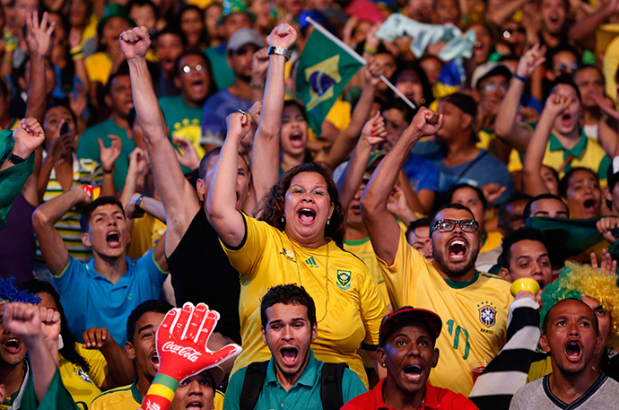 Brazilian soccer fans react while watching the opening soccer match Brazil against Croatia in a fan zone during the 2014 World Cup in Recife June 12, 2014 (Reuters / Yves Herman)