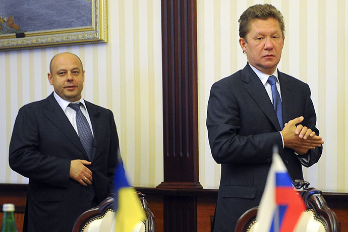 This handout picture taken and released by the Ukrainian Prime Minister press-service on June 16, 2014, shows Ukrainian Minister of Energy and Coal Industry Yuriy Prodan (L) and head Russian state gas firm Gazprom Alexei Miller (R) arriving for talks over Russia's gas supply to Ukraine, in Kiev. (AFP Photo / Andrew Kravchenko)