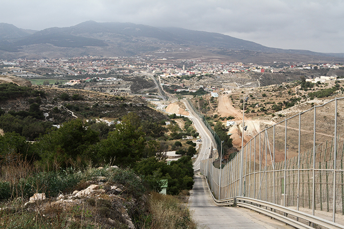 Melilla's wall and Mount Gurugu. Photo by @TomasoClavarino