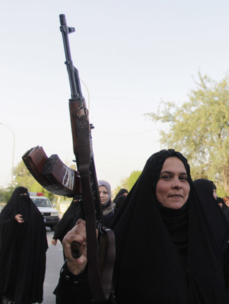raqi Shiite women shout slogans supporting the Iraqi army in Basra, southeast of Baghdad June 19, 2014. (Reuters/Essam Al-Sudani)