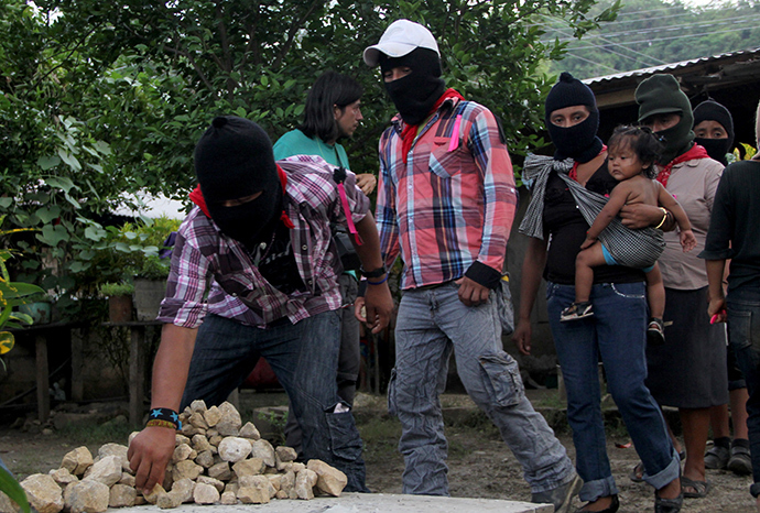 Zapatistas followers take part in the funeral of the teacher and Zapatista leader Jose Luis Solis Lopez in La Realidad, Chiapas State, Mexico (AFP Photo)