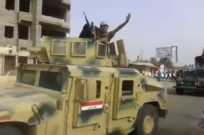 Militants from the Islamic State of Iraq and the Levant (ISIL) parading with an Iraqi army vehicle in the northern city of Baiji in the in Salaheddin province. (AFP Photo / HO / Youtube)