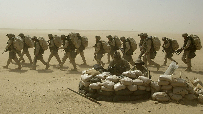 U.S. marines walk in full combat gears during a drill for infantry tactics in a stormy Kuwaiti desert on March 13, 2003 (Reuters / Oleg Popov)