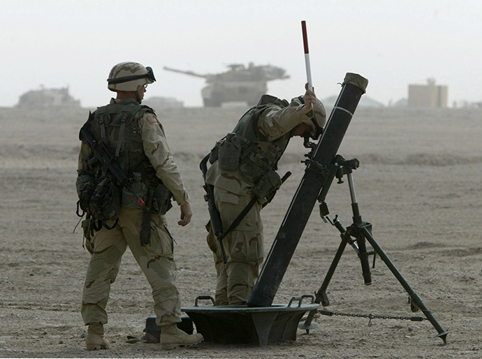 U.S. Soldiers from 2nd Battalion, 70 Armour, part of the 3rd Brigade Combat team of the 3rd Infantry Division, adjust their mortars in the northern Kuwait March 13, 2003 (Reuters)