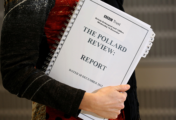 A journalist holds a copy of the Pollard Report into the BBC's handling of the child-sex abuse claims against late presenter Jimmy Savile upon the reports publication at BBC Broadcasting House in London on December 19, 2012 (AFP Photo)