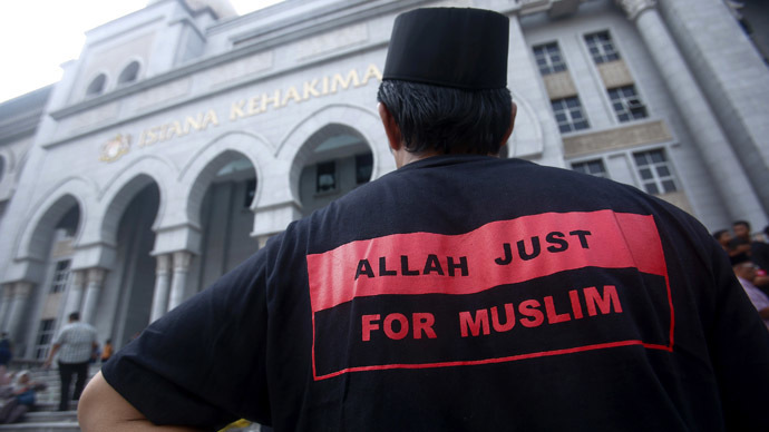 A Muslim man stands outside the court in Putrajaya outside Kuala Lumpur June 23, 2014. (Reuters/Samsul Said)