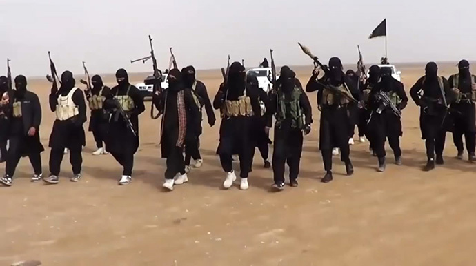 An image grab taken from a propaganda video uploaded on June 11, 2014 by jihadist group the Islamic State of Iraq and the Levant (ISIL) allegedly shows ISIL militants gathering at an undisclosed location in Iraq's Nineveh province. (AFP Photo / HO / ISIL)