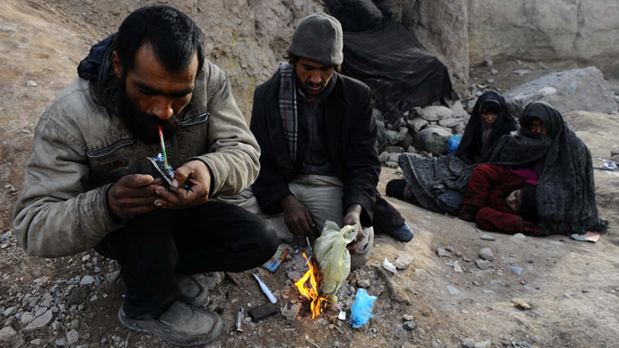 An Afghan drug addict smokes heroin in the city of Herat. (AFP Photo/Aref Karim)