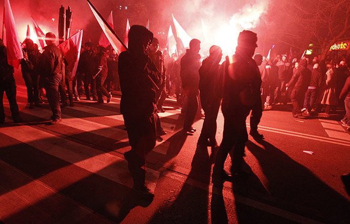 Far-right protesters walk during the annual far-right march, which coincides with Poland's National Independence Day in Warsaw November 11, 2013. (Reuters / Kacper Pempel)