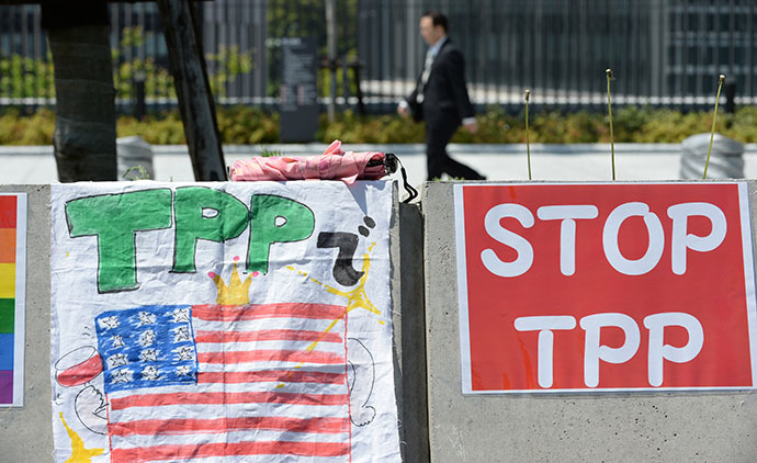 Placards are placed on the wall during a sit-in protest against the Trans Pacific Partnership (TPP) trade deal (AFP Photo / Toshifumi Kitamura)