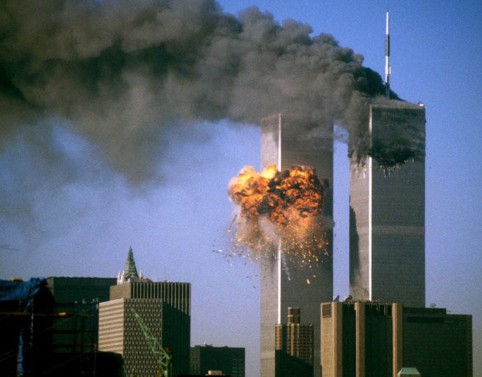 The World Trade Center south tower (L) burst into flames after being struck by hijacked United Airlines Flight 175 as the north tower burns following an earlier attack by a hijacked airliner in New York City September 11, 2001. (Reuters)