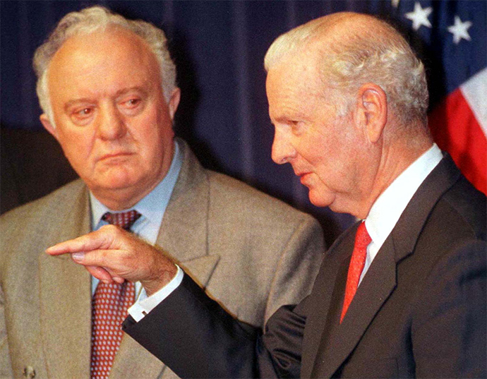 Former Secretary of State James Baker, III (R) and Republic of Georgia President Eduard Shevardnadze discuss the Kosovo conflict during a media briefing in Houston April 22, 1999 (Reuters)