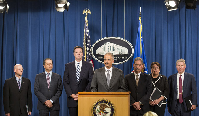 U.S. Attorney General Eric Holder speaks at a news conference after the French bank BNP Paribas plead guilty to a criminal charge in connection with its violations of U.S. sanctions on Sudan and other countries in Washington on June 30, 2014. (Reuters)