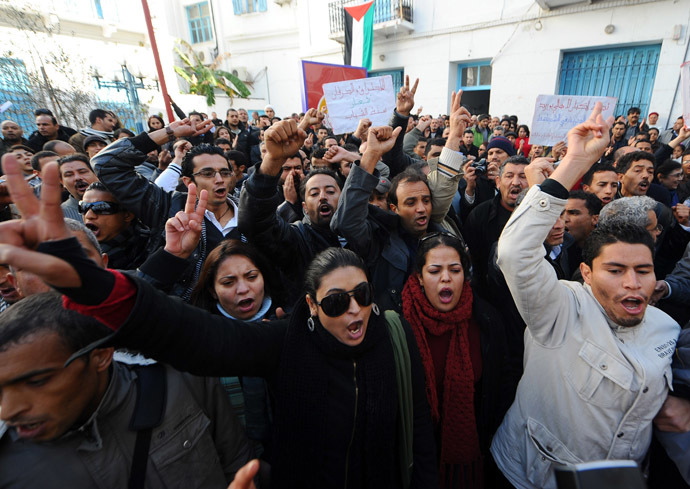 People shout slogans to show their solidarity with the residents of Sidi Bouzid during a demonstration on December 27, 2010 in Tunis. (AFP Photo)