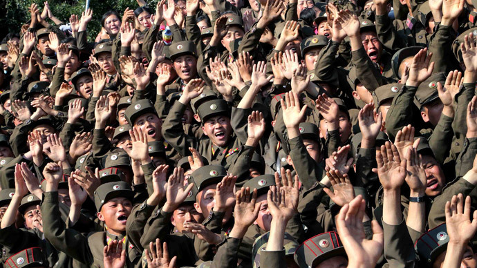 Soldiers wave during a visit by North Korean leader Kim Jong Un.(Reuters / KCNA)