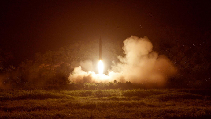 A tactical rocket firing drill carried out by units of the Korean People's Army (KPA) Strategic Force is seen during a visit by North Korean leader Kim Jong Un in the western sector of the front in this undated photo released by North Korea's Korean Central News Agency (KCNA) in Pyongyang on July 10, 2014.(Reuters / KCNA)