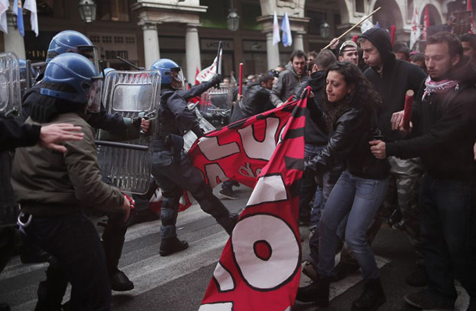 Anti-riot policemen clash with demonstrators in Turin during one of several rallies against unemployment and austerity in Italy. (AFP Photo / Marco Bertorello)