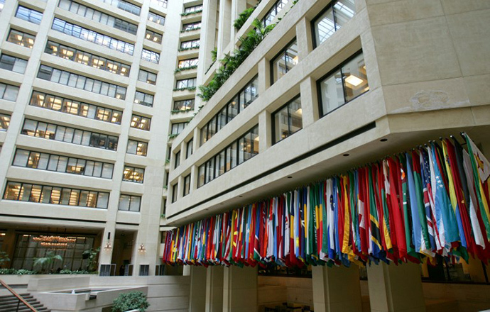 The International Monetary Fund Headquarter Buildings' central atrium has flags representing all the participating countries in Washington, DC. (AFP Photo / Tim Sloan)