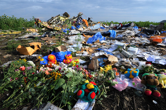 Flowers and plush toys are left at the site of the crash of a Malaysia Airlines plane carrying 298 people from Amsterdam to Kuala Lumpur in Grabove, in rebel-held eastern Ukraine, on July 19, 2014. AFP Photo / Dominique Faget)