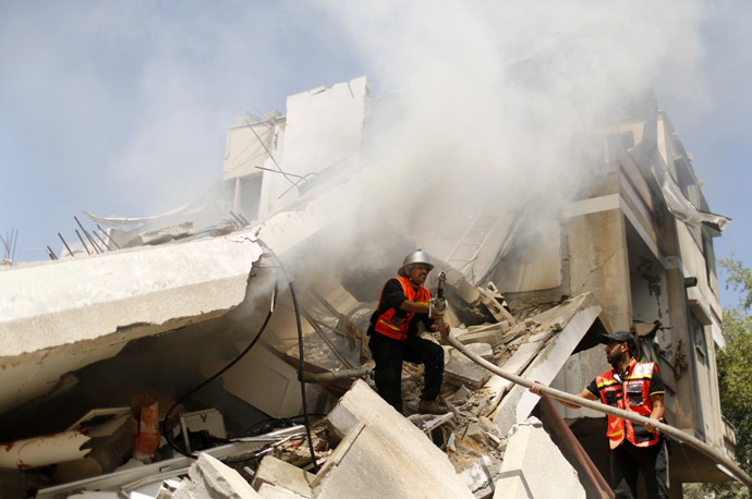 Palestinian firefighters extinguish a fire following what witnesses said was an Israeli air strike on a house, in Gaza City July 23, 2014. (Reuters)