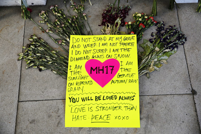 Flowers and messages for the victims of flight MH17 are seen outside Malaysia's High Commission in central London July 22, 2014 (Reuters/Luke MacGregor)