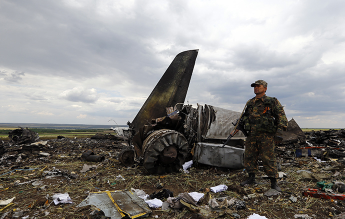 An armed member of self-defenses forces stands guard at the site of the crash of the Il-76 Ukrainian army transport plane in Luhansk June 14, 2014. (Reuters / Shamil Zhumatov)
