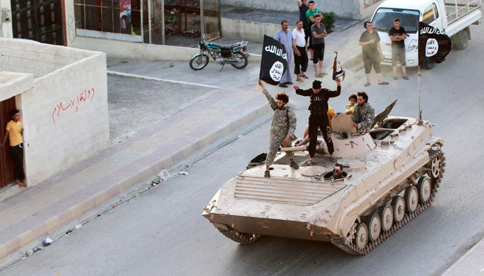 Militant Islamist fighters take part in a military parade along the streets of northern Raqqa province (Reuters / Stringer)