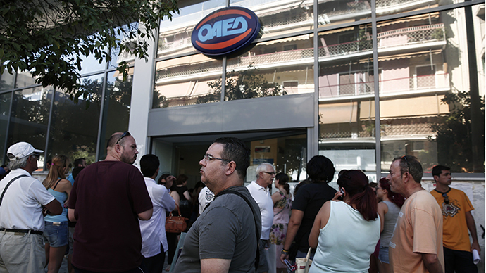 People wait outside a Greek Manpower Employment Organisation (OAED) office at Kalithea suburb in Athens (Reuters / Yorgos Karahalis)