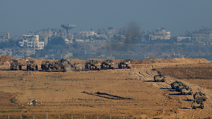 Israeli army tanks and armoured vehicles are seen in Gaza near the border with Israel July 30, 2014 (Reuters / Baz Ratner)