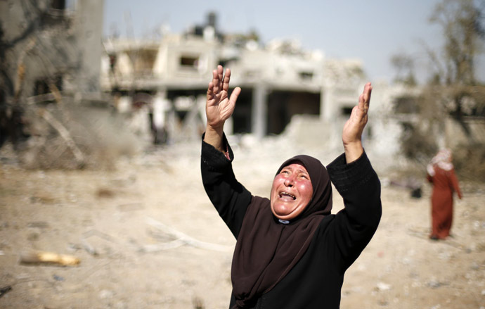 A Palestinian woman reacts upon seeing her destroyed house in Beit Hanoun town, which witnesses said was heavily hit by Israeli shelling and air strikes during Israeli offensive, in the northern Gaza Strip August 1, 2014. (Reuters/Suhaib Salem)