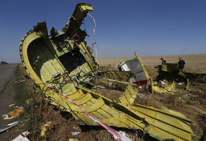 Members of a group of international experts inspect the site where the downed Malaysia Airlines flight MH17 crashed, near the village of Hrabove (Grabovo) in Donetsk region, eastern Ukraine August 1, 2014. (Reuters)