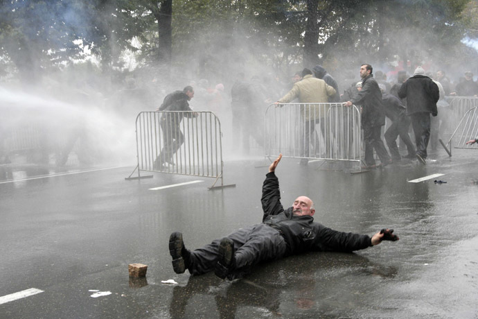 An opposition supporter lies on the road during clashes with police in central Tbilisi November 7, 2007. (Reuters)