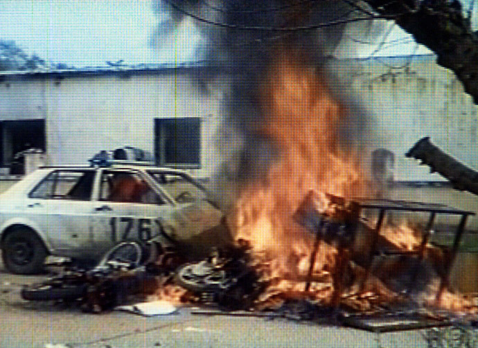 A police vehicle burns during riots in the northwestern Argentine province of Salta, November 10, 2000. Hundreds of poor and jobless Argentines put up a roadblock, set fire to a police station and looted shops after a man was shot dead and ten were injured in clashes with police. (Reuters)