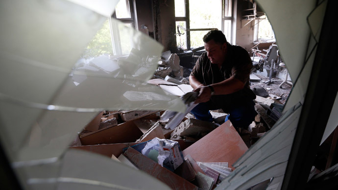 A man inspects wreckage inside a damaged building following what locals say was shelling by Ukrainian forces in Donetsk August 7, 2014.(Reuters / Sergei Karpukhin)